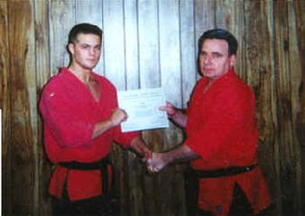 Todd Fox with Martin of Centurion in 1995 New Black Belt