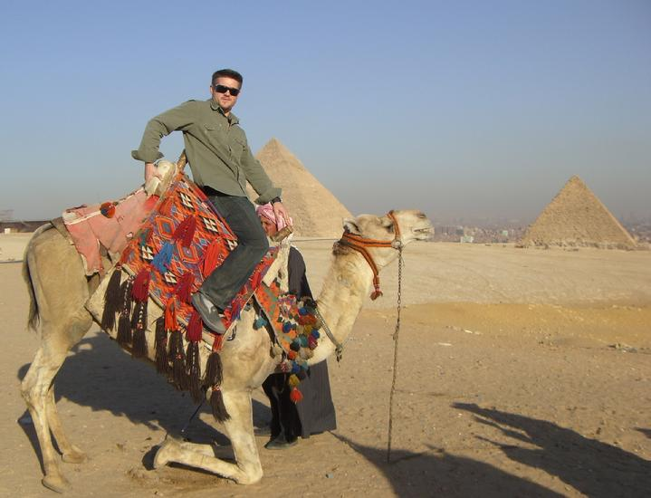 Todd Fox Ridding a camel like a bull
